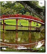 Japanese Gardens Red Bridge And Reflection In Pond With