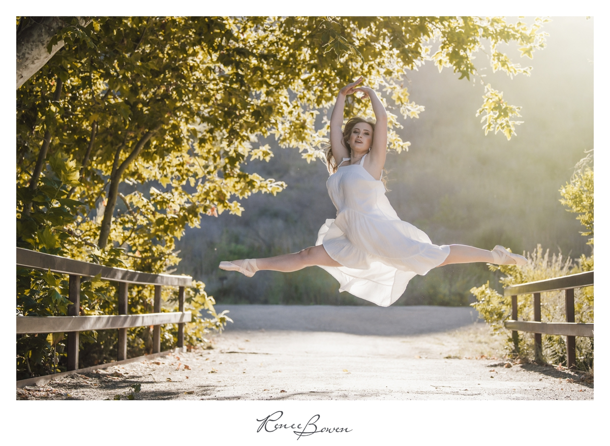 ballerina jumping in white dress