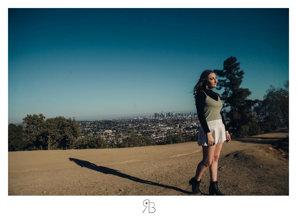 girl in white mini skirt overlooking valley renee bowen seniors