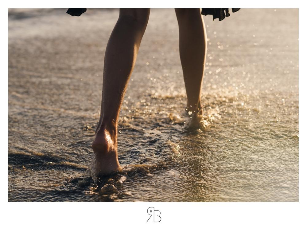 girl walking on beach close up wearing black sundress Renee Bowen Senior Photography