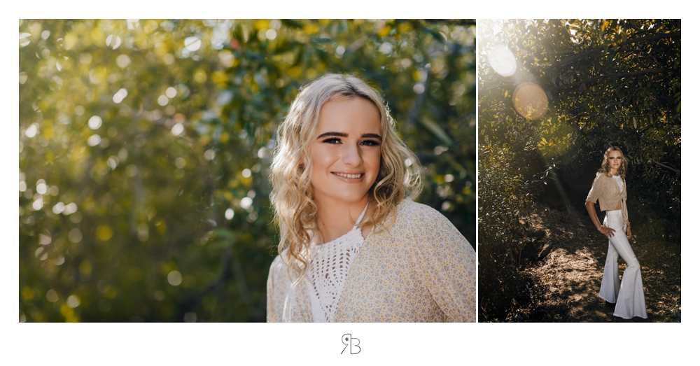 Girl in natural setting backlit wearing tan sweater and white bell bottoms Renee Bowen Seniors