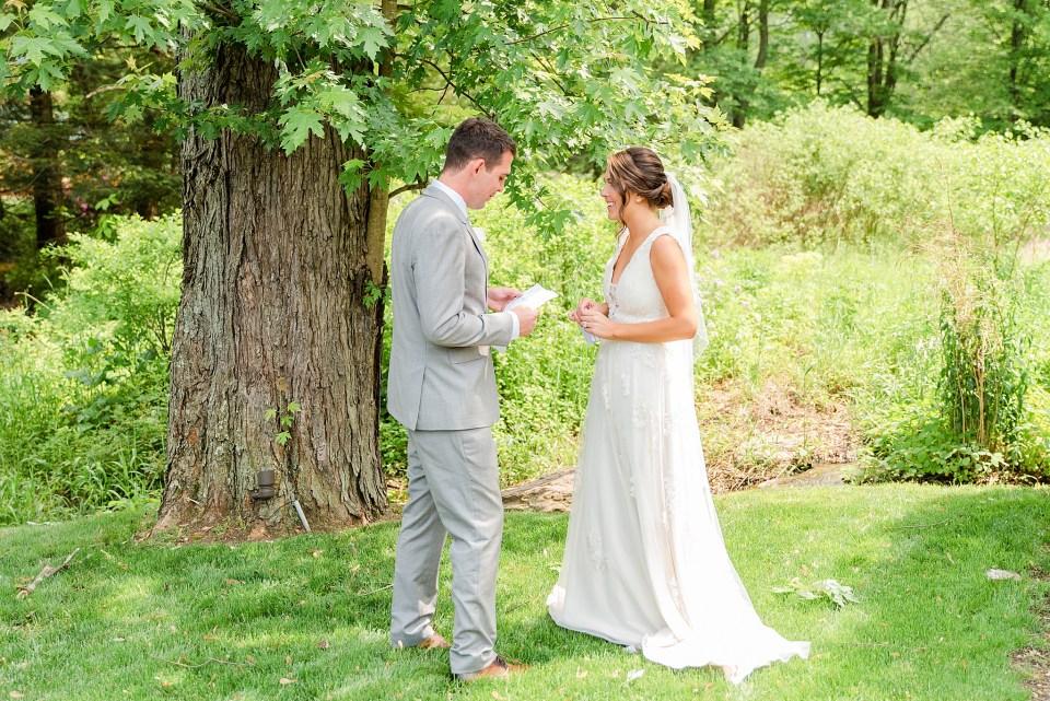 bride and groom exchange letters on wedding day photographed by PA wedding photographer Renee Nicolo Photography