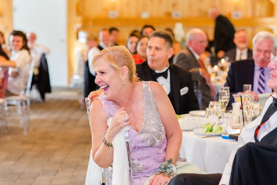 mother of groom enjoys toasts photographed by wedding photographer Renee Nicolo Photography