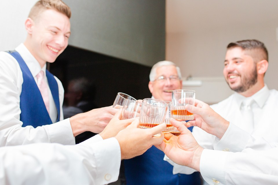 groom and groomsmen cheer French Creek Golf Club wedding day photographed by Renee Nicolo Photography