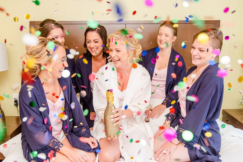 bride and bridesmaids celebrate wedding day photographed by Renee Nicolo Photography