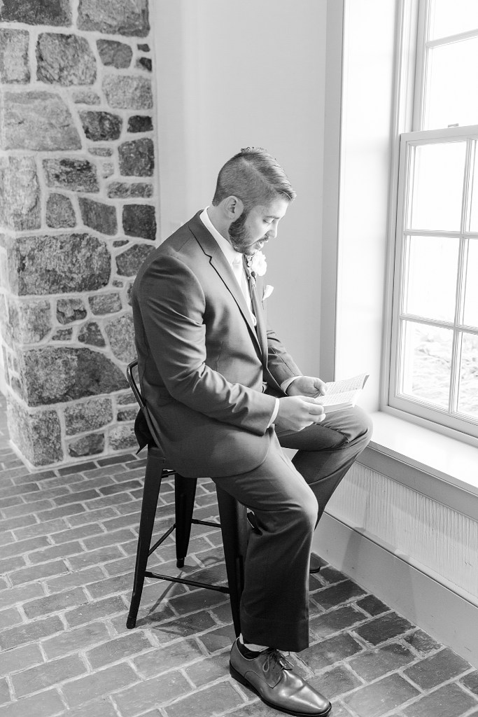 groom reads letter on wedding day in PA with Renee Nicolo Photography