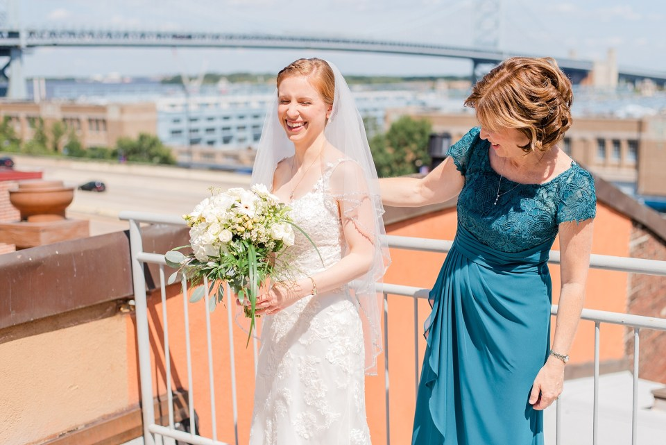 mother helps daughter with veil on wedding day in Philly photographed by Renee Nicolo Photography