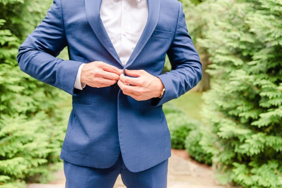 groom buttons suit jacket photographed by Renee Nicolo Photography