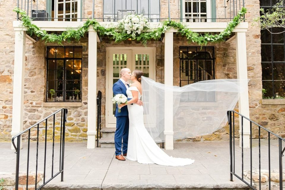 dramatic wedding portrait with veil for bride and groom photographed by Renee Nicolo Photography