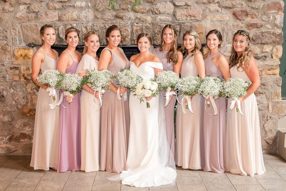 bridesmaids in pink photographed by Renee Nicolo Photography