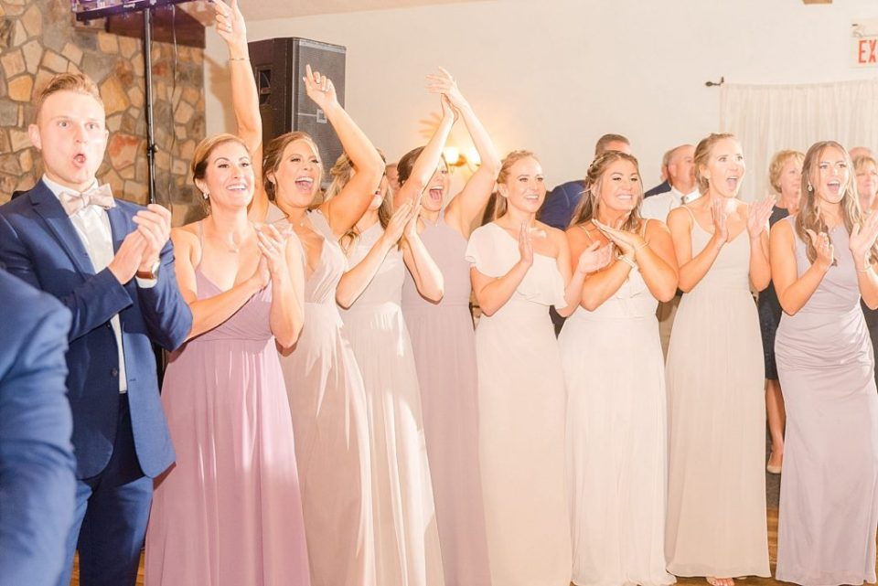 bridal party welcomes newlyweds to reception photographed by Renee Nicolo Photography