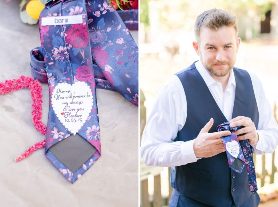 groom opens tie from bride photographed by Renee Nicolo Photography
