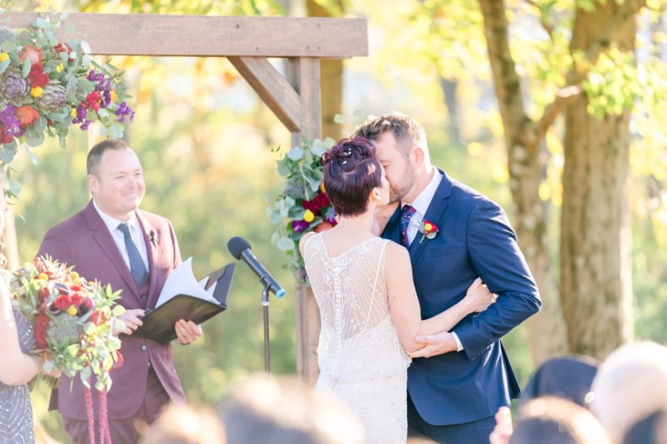 first kiss as husband and wife at Historic Stonebrook Farm photographed by Renee Nicolo Photography