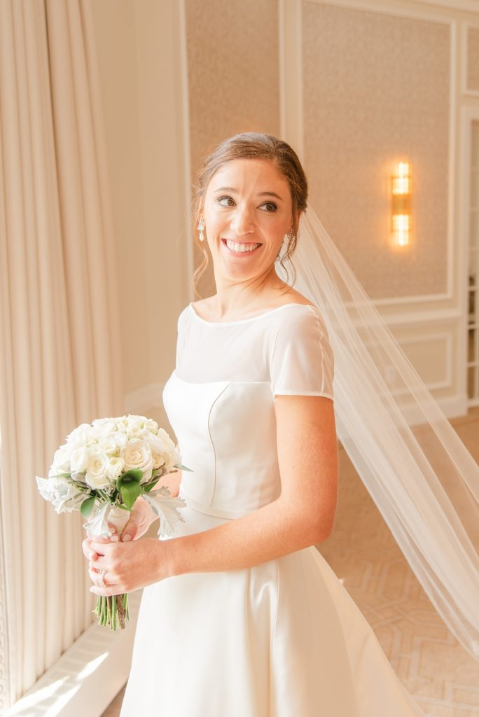portrait of bride in wedding gown photographed by Renee Nicolo Photography