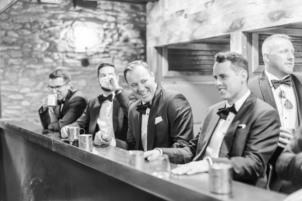 groom and groomsmen in wine cellar photographed by Renee Nicolo Photography