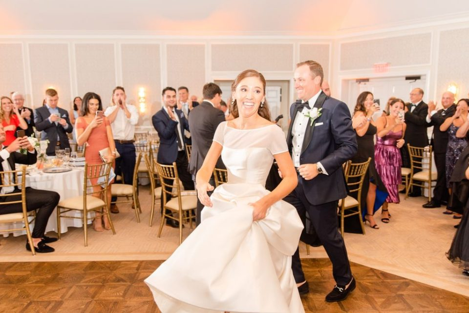bride and groom enter reception photographed by Renee Nicolo Photography