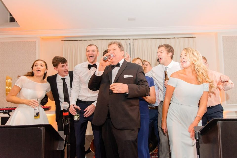 bride and her father sing with the band at Whitemarsh Country Club with Renee Nicolo Photography