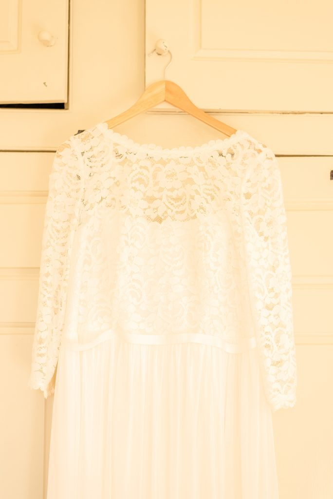 bride's lace dress photographed by Renee Nicolo Photography