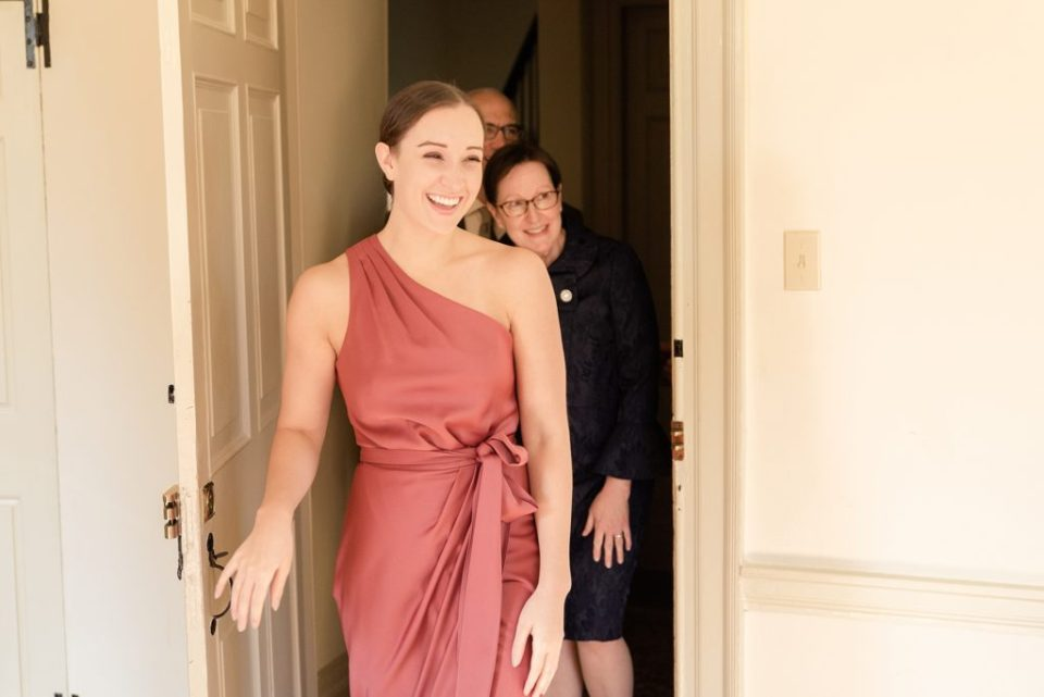 first look with bridesmaid and family by Renee Nicolo Photography