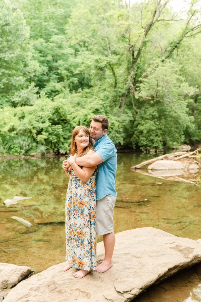 engagement portraits on rocks in river by Renee Nicolo Photography