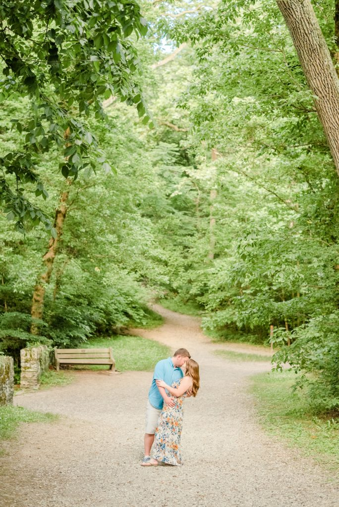 bride and groom kiss in walkway in local park photographed by Renee Nicolo Photography