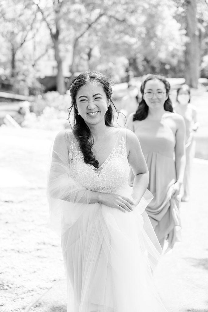 bride walks to Cooper Pond Park for first look with groom