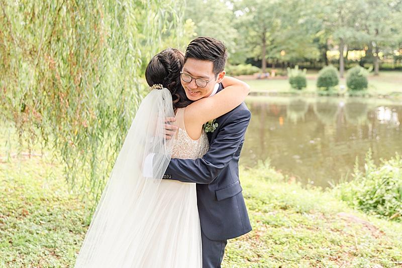 bride and groom hug during first look before NJ backyard wedding