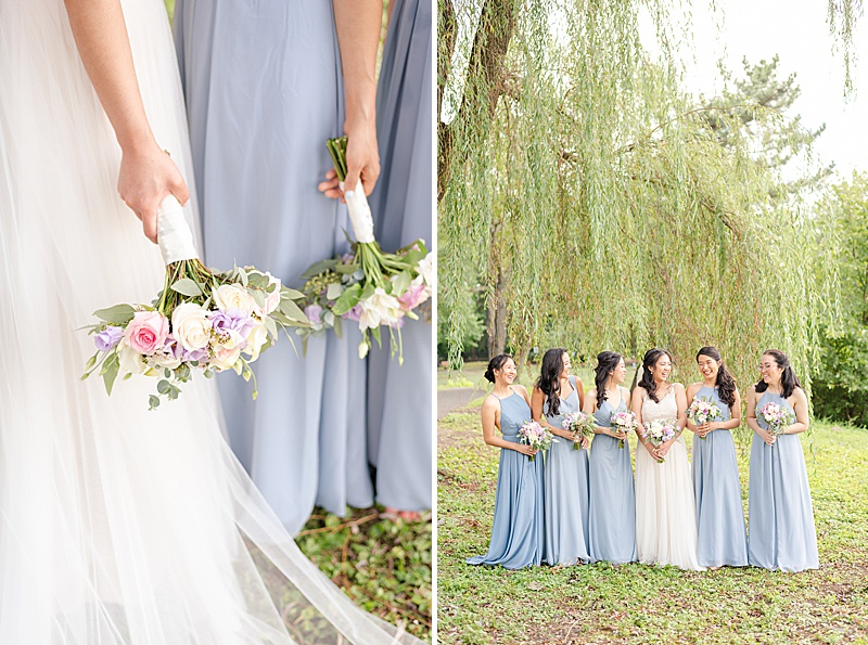 bridesmaids in blue gowns look at bride