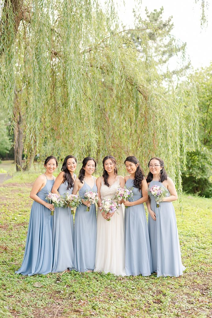 bridesmaids in blue gowns