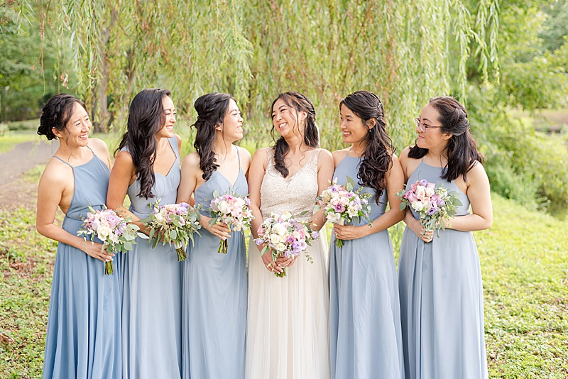 New Jersey bridesmaids pose at Cooper Pond Park