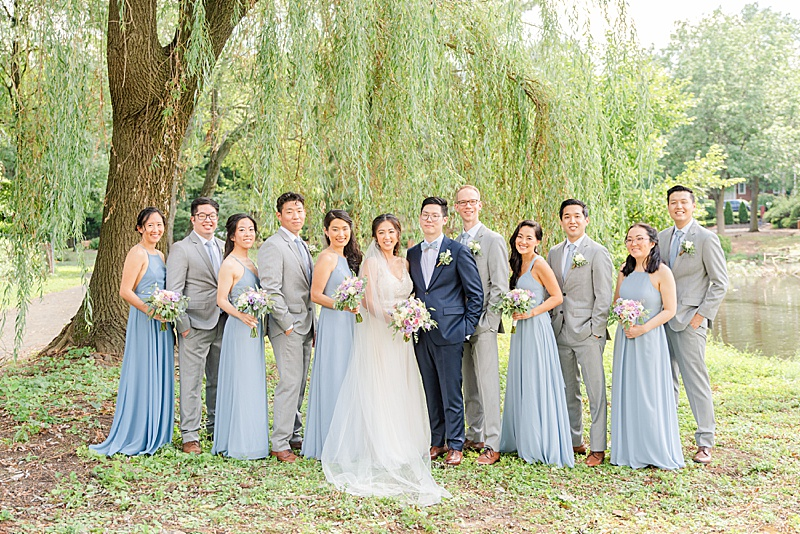 bride and groom pose with bridal party at Cooper Pond Park