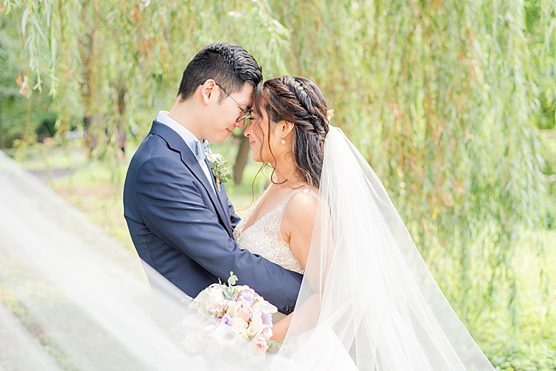 bride and groom pose nose to nose in New Jersey