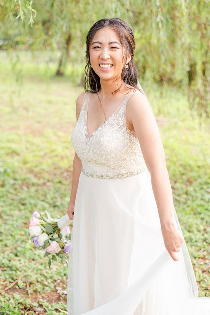 bride twirls Wtoo gown from BHLDN