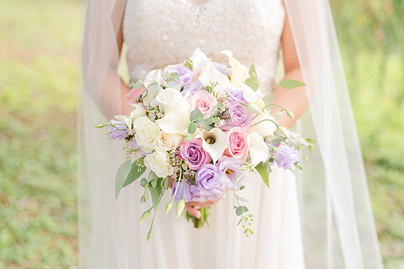 bride's pink and purple wedding bouquet with lilies