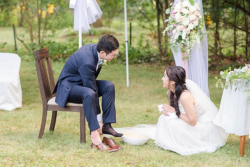 bride prepares to wash groom's feet