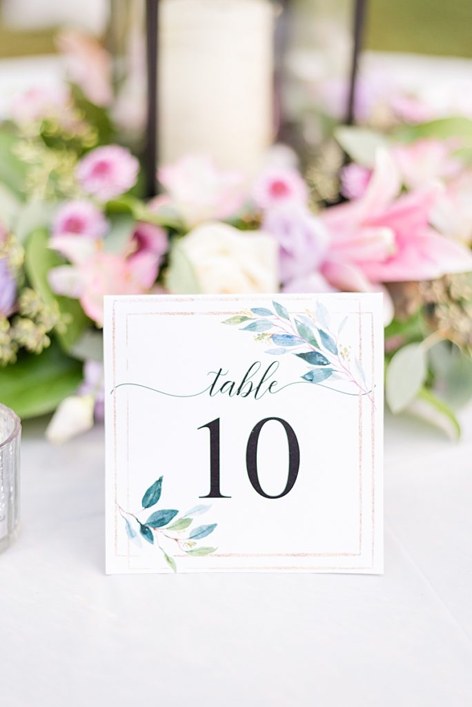 centerpiece and table numbers for NJ backyard wedding reception