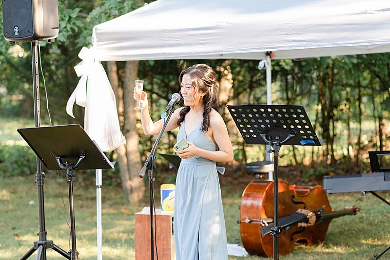bridesmaid gives toast during NJ backyard wedding reception