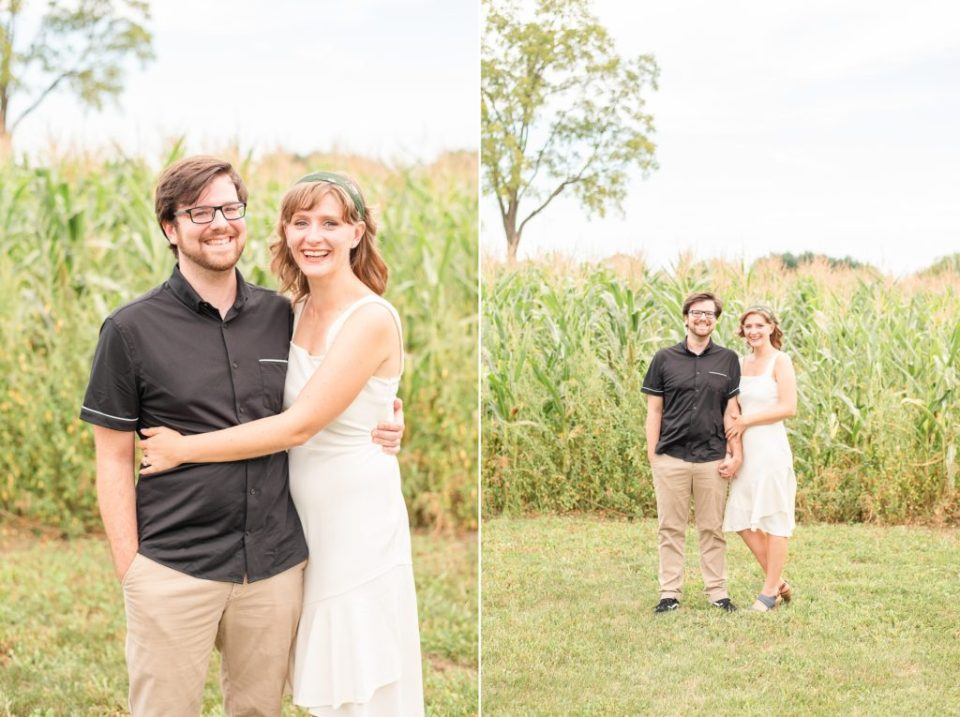 couple in white dress and black shirt poses at Historic Stonebrook Farm