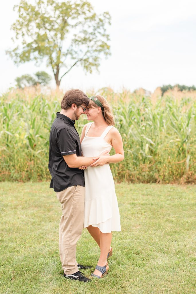 engaged couple touches noses at Historic Stonebrook Farm