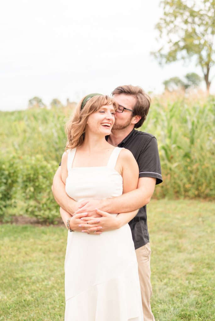 bride and groom snuggle during Historic Stonebrook Farm engagement session