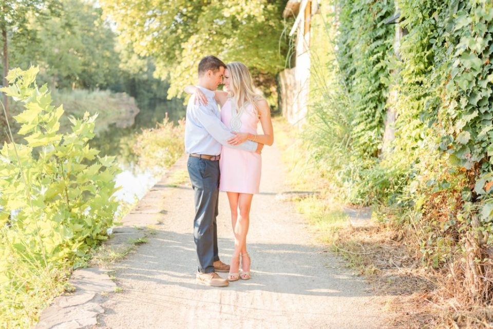groom holds bride during engagement portraits New Hope