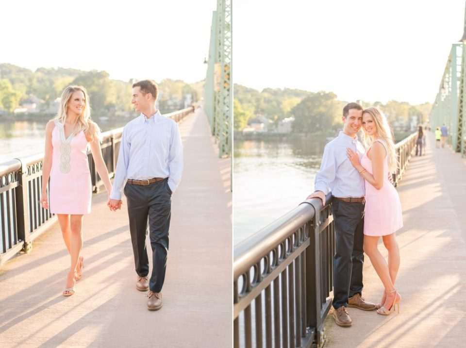 bride in pale pink dress holds groom's hand while walking along New Hope bridge