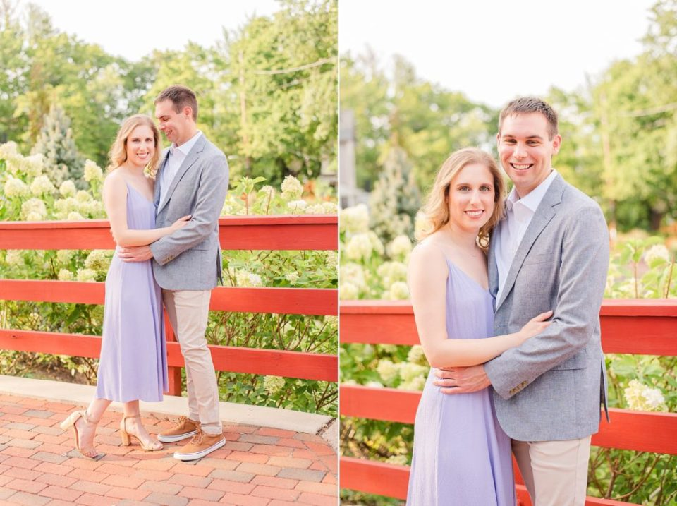 couple poses on bridge with red planks