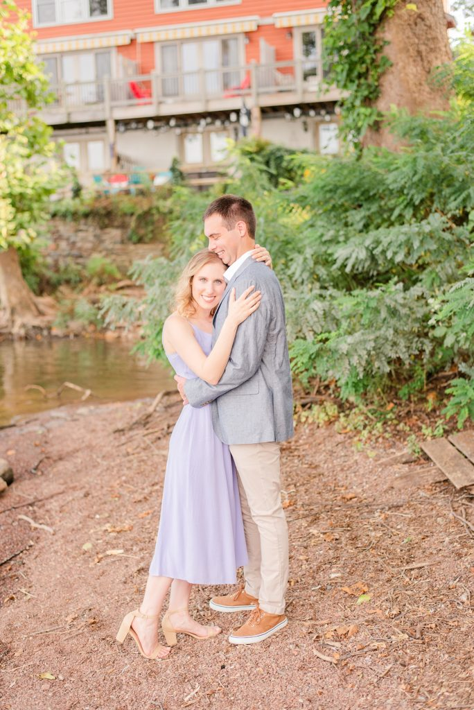 bride in lilac dress hugs groom during engagement session