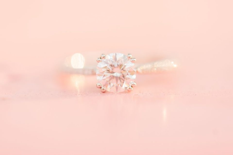 engagement ring on pink board for PA engagement portraits