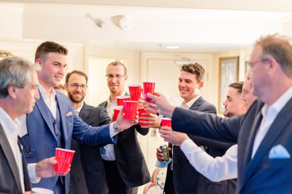 groom toasts with groomsmen before wedding day