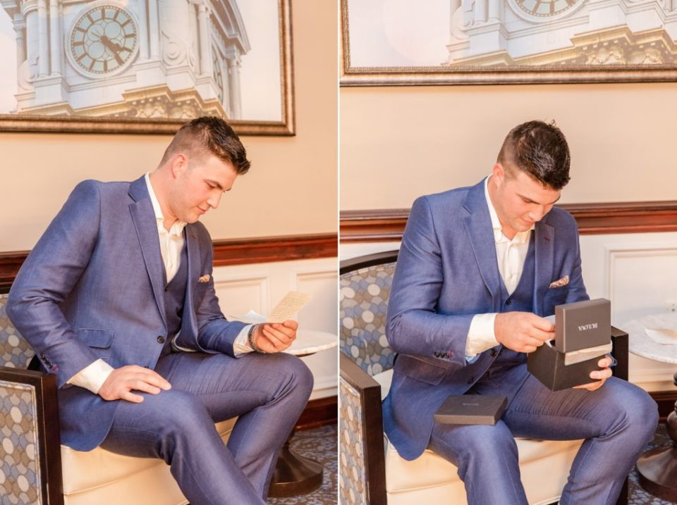 groom opens gift from bride to be on wedding day
