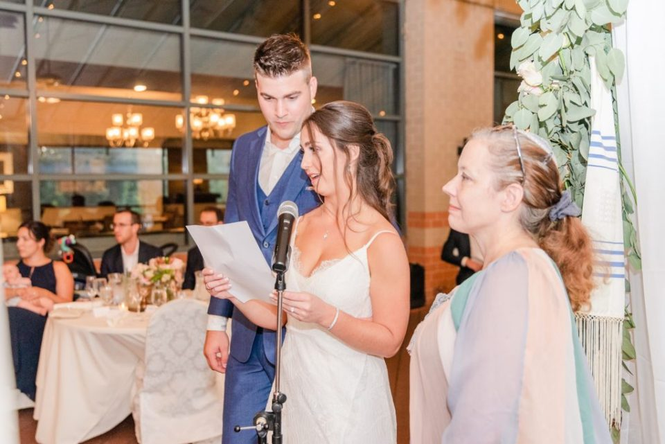 bride and groom give speech to parents during wedding ceremony