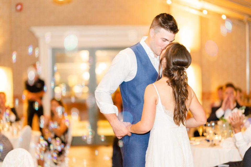newlyweds kiss after first dance