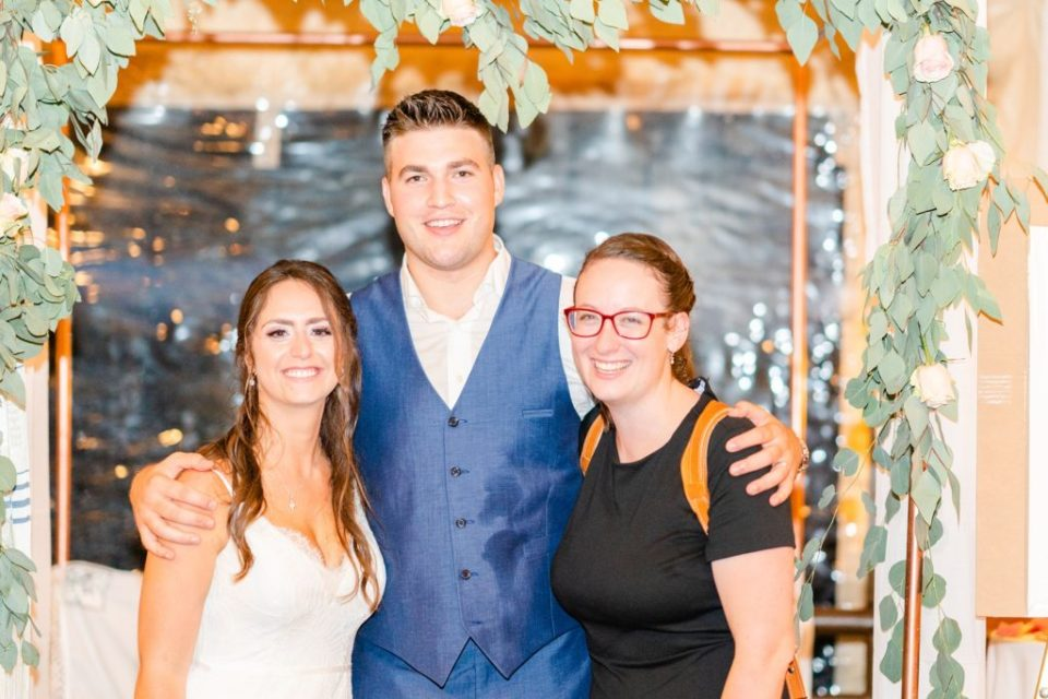 Renee Nicolo Photography poses with couple at the Hotel Desmond Malvern